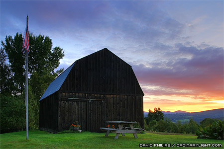 Photograph: Flag and Barn at Sunrise